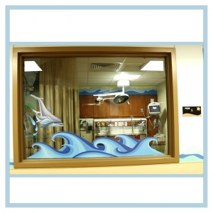 dolphin-decal-on-window-waves-mural-hospital-art-healthcare-design