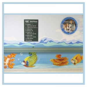 hallway-design-in-hospitals-healthcare-art-porthole-frame-3d-fish-and-waves