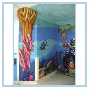 pediatric-entrance-murals-on-walls-healthcare-design-hospital-art-3d-fish-coral-columns-welcome-sign