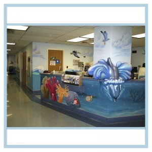 pediatric-unit-art-healthcare-design-murals-3d-fish-custom-bookcase-nurses-station-dolphin