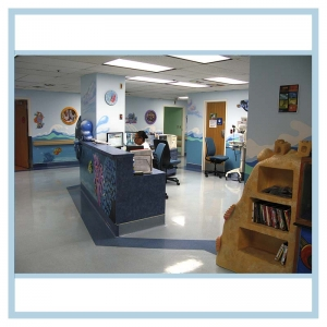 pediatric-unit-art-healthcare-design-murals-3d-fish-custom-bookcase-nurses-station
