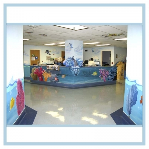 pediatric-unit-entrance-art-healthcare-design-murals-3d-fish-custom-bookcase-nurses-station-dolphin