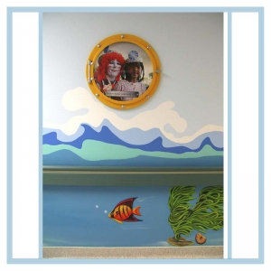 porthole-frame-prints-wall-art-waves-in-hallway-healthcare-design-hospital-decorations-clown