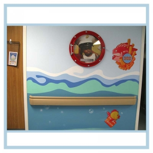 porthole-frame-with-childs-picture-room-number-hospital-art-healthcare-design-fish