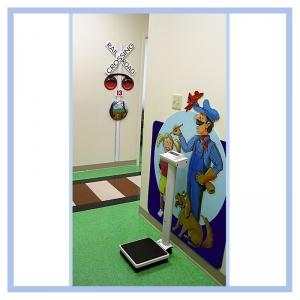 conductor-railroad-theme-childrens-clinic-art-healthcare-design