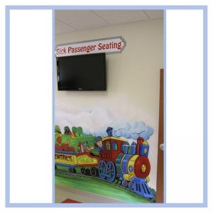 sick-patient-seating-train-theme-healthcare-design-hospital-art