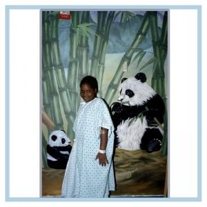 patient-enjoying-artwork-pandas-bamboo-rainforest-theme-hospital-art-healthcare-design
