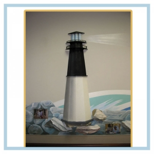 lighthouse-rocks-waves-hospital-design-healthcare-art-tropcial-nautical-theme