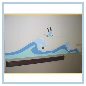 tropical-theme-waves-down-hallway-3d-bird-healthcare-design-hospital-art