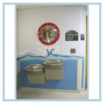 porthole-frame-prints-wall-art-waves-in-hallway-healthcare-design-hospital-decorations