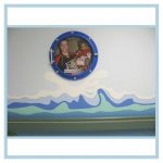porthole-frame-wall-art-waves-in-hallway-healthcare-design-hospital-decorations